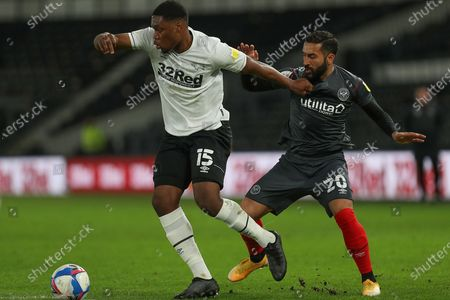 Derby County defender Teden Mengi (15) and Brentford midfielder Saman Ghoddos (20) during the EFL Sky Bet Championship match between Derby County and Brentford at the Pride Park, Derby