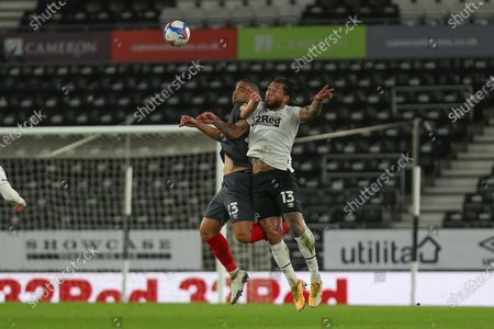 Brentford defender Winston Reid (23) and Derby County forward Colin Kazim-Richards (13) during the EFL Sky Bet Championship match between Derby County and Brentford at the Pride Park, Derby