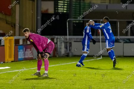 Lincoln City Goalkeeper Alex Palmer (on loan from West Brom) (1) is beaten as Gillingham FC midfielder Jordan Graham (10) celebrates during the EFL Sky Bet League 1 match between Lincoln City and Gillingham at Sincil Bank, Lincoln