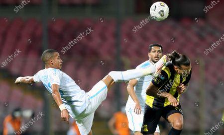 Stock Photo of Al-Ittihad's player Aleksandar Prijovic (R) in action against Al-Fateh's Sofiane Bendebka (L) during the Saudi King's Cup Quarter-final soccer match between Al-Ittihad and Al-Fateh at King Abdulaziz Stadium, Mecca, Saudi Arabia, 16 March 2021.