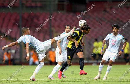 Al-Ittihad's player Aleksandar Prijovic (2-R) in action against Al-Fateh's Sofiane Bendebka (L) during the Saudi King's Cup Quarter-final soccer match between Al-Ittihad and Al-Fateh at King Abdulaziz Stadium, Mecca, Saudi Arabia, 16 March 2021.