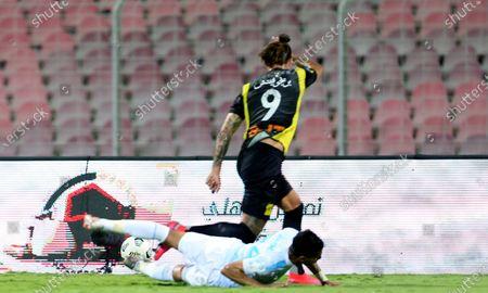 Al-Ittihad's player Aleksandar Prijovic (up) in action against Al-Fateh's Amaar Al Dohaim (down) during the Saudi King's Cup Quarter-final soccer match between Al-Ittihad and Al-Fateh at King Abdulaziz Stadium, Mecca, Saudi Arabia, 16 March 2021.