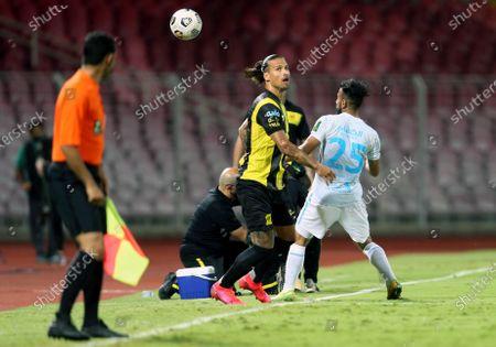 Stock Picture of Al-Ittihad's player Aleksandar Prijovic (2-L) in action against Al-Fateh's Tawfiq Buhumaid (R) during the Saudi King's Cup Quarter-final soccer match between Al-Ittihad and Al-Fateh at King Abdulaziz Stadium, Mecca, Saudi Arabia, 16 March 2021.