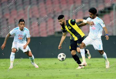 Al-Ittihad's player Abdulrahman Alobud (C) in action against Al-Fateh's Christian Cueva (L) and Nawaf Boushal (R) during the Saudi King's Cup Quarter-final soccer match between Al-Ittihad and Al-Fateh at King Abdulaziz Stadium, Mecca, Saudi Arabia, 16 March 2021.