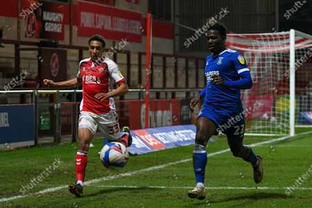 Fleetwood Town's defender James Hill (33) and Ipswich Town's defender Aristote Nsiala (22) chase the ball during the EFL Sky Bet League 1 match between Fleetwood Town and Ipswich Town at the Highbury Stadium, Fleetwood
