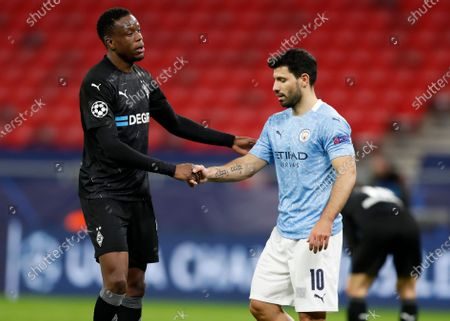 Moenchengladbach's Denis Zakaria, left, and Manchester City's Sergio Aguero shake hands following the Champions League round of 16 second leg soccer match between Manchester City and Borussia Moenchengladbach at the Puskas Arena in Budapest, Hungary