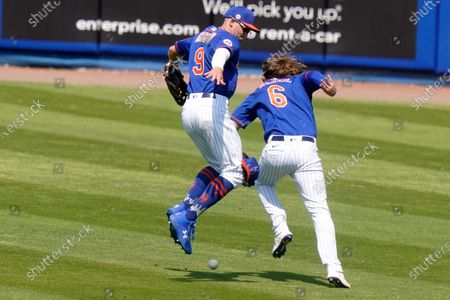 New York Mets center fielder Brandon Nimmo (9) and second baseman Jeff McNeil (6) can't get to a two-run double hit by Houston Astros' Taylor Jones during the sixth inning of a spring training baseball game, in Port St. Lucie, Fla