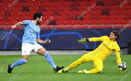 Ilkay Guendogan of Manchester City (L) scores against goalie Yann Sommer of Borussia Moenchengladbach during the UEFA Champions League round of 16 second leg soccer match between Manchester City and Borussia Moenchengladbach in the Puskas Ferenc Arena in Budapest, Hungary, 16 March 2021.