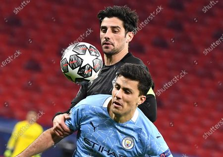 Joao Cancelao of Manchester City (R) and Lars Stindl of Borussia Moenchengladbach vie for the ball during the UEFA Champions League round of 16 second leg soccer match between Manchester City and Borussia Moenchengladbach in the Puskas Ferenc Arena in Budapest, Hungary, 16 March 2021.