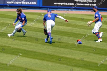 New York Mets center fielder Brandon Nimmo (9), second baseman Jeff McNeil (6) and right fielder Kevin Pillar, right, can't get to a RBI double hit by Houston Astros' Taylor Jones to score two runs during the sixth inning of a spring training baseball game, in Port St. Lucie, Fla