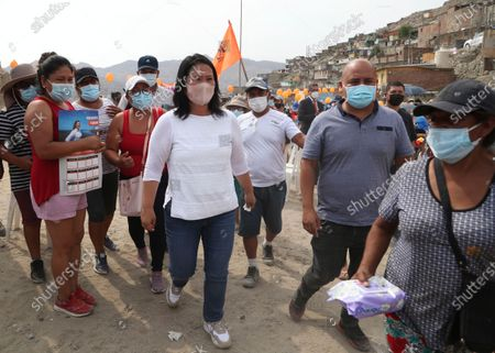 Wearing a mask to curb the spread of the new coronavirus, presidential candidate and daughter of imprisoned ex-President Alberto Fujimori, Keiko Fujimori, of the Popular Force party, campaigns in San Juan de Lurigancho on the outskirts of Lima, Peru, . Peru's general election is set for April 11