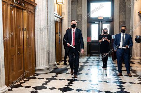 U.S. Senator John Hickenlooper (D-CO) walking towards the Senate Chamber.