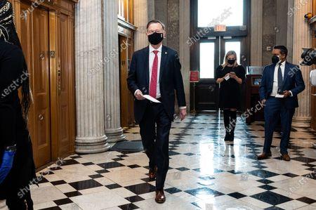 March 16, 2021 - Washington, DC, United States:   U.S. Senator John Hickenlooper (D-CO) walking towards the Senate Chamber.
