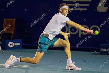 Grigor Dimitrov of Bulgaria in action against Adrian Mannarino of France during the Mexican Tennis Open in Acapulco, Guerrero state, Mexico, 16 March 2021.