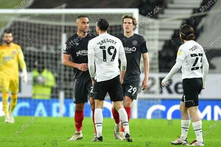 Lee Gregory of Derby County confronts Winston Reid of Brentford during the Sky Bet Championship match between Derby County and Brentford at the Pride Park, Derby on Tuesday 16th March 2021.
