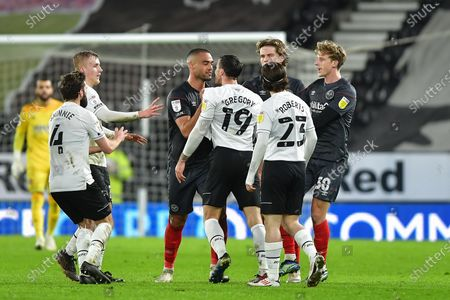 Tempers flare-up between Winston Reid of Brentford  and Lee Gregory of Derby County during the Sky Bet Championship match between Derby County and Brentford at the Pride Park, Derby on Tuesday 16th March 2021.