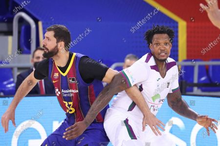 Stock Photo of Deon Marshall Thompson and Nikola Mirotic during the match between FC Barcelona and Unicaja Malaga, corresponding to the week 25 of the spanish Liga Endesa , played at the Palau Blaugrana, on 16th March 2021, in Barcelona, Spain.  --