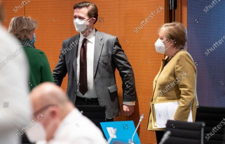 (L-R) Monika Gruetters, Federal Government Commissioner for Culture and the Media, Steffen Seibert, German government spokesperson, and German Chancellor Angela Merkel attending a cabinet meeting at the chancellery in Berlin, Germany, 17 March 2021.