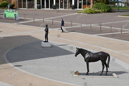 The Best Mate and Sir Tony McCoy statues in isolation on St Patrick's Day.Photo © Hugh Routledge