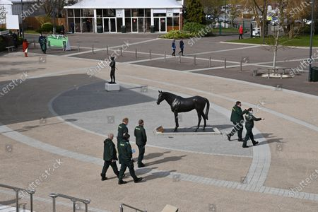 Stock Picture of The Best Mate and Sir Tony McCoy statues in isolation on St Patrick's Day as ambulance crews pass by.Photo © Hugh Routledge