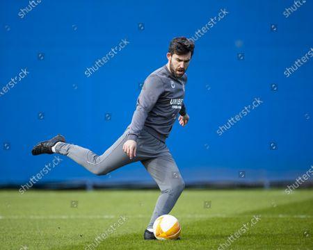 Stock Image of Rangers 1st team analyst Scott Mason kicks a ball during training ahead of tomorrow nights Europa League last 16 match against Slavia Praha.