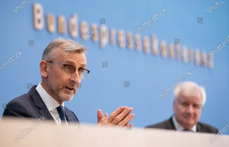 Armin Schuster (L), President of the Federal Office for Civil Protection and Disaster Relief and Horst Seehofer (R), German Minister of the Interior, at a press conference to strengthen population protection by realigning the Federal Office for Civil Protection in Berlin, Germany, 17 March 2021.