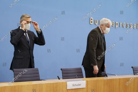 German Interior Minister Horst Seehofer, right, and Federal Office of Civil Protection and Disaster Assistance President Armin Schuster, left, arrive for a a news conference in Berlin, Germany, . The news conference is about the new structure of the Federal Office of Civil Protection and Disaster Assistance