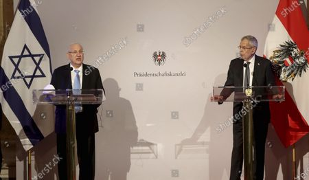Israeli President Reuven Rivlin and Austrian President Alexander Van der Bellen, from left, address the media during a joint press conference after their meeting at the Hofburg palace in Vienna, Austria