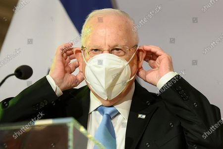 Israel's president Reuven Rivlin puts on his protective face mask next to Austrian Federal President Alexander Van der Bellen after a press conference at the Hofburg Palace, in Vienna, Austria, 17 March 2021. Israel's President Reuven Rivlin is on a one day visit to Vienna.