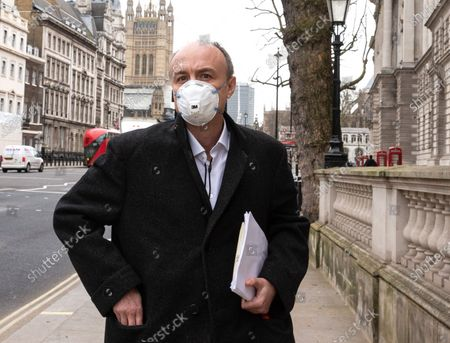 Stock Image of Dominic Cummings leaves Portcullis House. He criticised the Department of Health, calling it a 'total disaster' on procurement. He called it a 'smoking ruin'.Dominic Cummings appeared before the Science Committee at Portcullis house, chaired by Greg Clark.