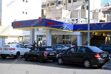 Stock Image of Vehicles line up at a gas station, in Beirut, Lebanon, 17 March 2021. The Lebanese Ministry of Energy and Water on 17 March 2021 increased fuel prices, raising the petrol price to 1,945 LP (1.28 US dollar) per liter. The dollar exchange rate on the parallel market has topped 14,500 Lebanese pounds a spike from the pegged rate of 1,507.
