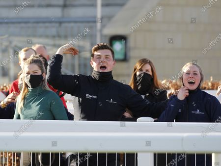 Jonjo O'Neill travelling Head Lad Harrison Day cheers home Sky Pirate in the Johnny Henderson Grand Annual Chase at Cheltenham.