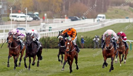 PUT THE KETTLE ON (centre, Aidan Coleman) beats NUBE NEGRA (2nd left) GREANETEEN (left) and CHACUN POUR SOI (right) in The Betway Queen Mother Champion Chase Cheltenham