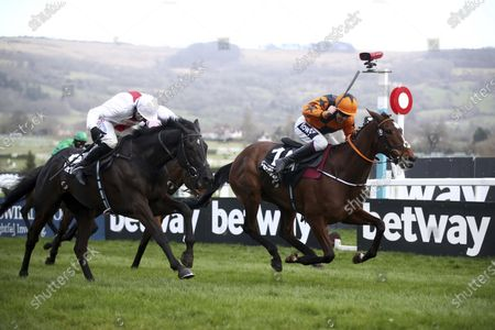 Put The Kettle On ridden by Aidan Coleman, right, wins the Queen Mother Champion Chase on day two of the Cheltenham Festival at Cheltenham Racecourse, England