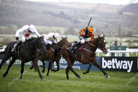 Put The Kettle On ridden by Aidan Coleman, right, goes on to win the Queen Mother Champion Chase on day two of the Cheltenham Festival at Cheltenham Racecourse, England