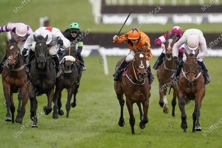 Put The Kettle On ridden by Aidan Coleman, center, goes on to win the Queen Mother Champion Chase on day two of the Cheltenham Festival at Cheltenham Racecourse, England