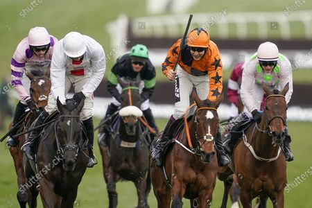 Put The Kettle On ridden by Aidan Coleman, second right, goes on to win the Queen Mother Champion Chase on day two of the Cheltenham Festival at Cheltenham Racecourse, England