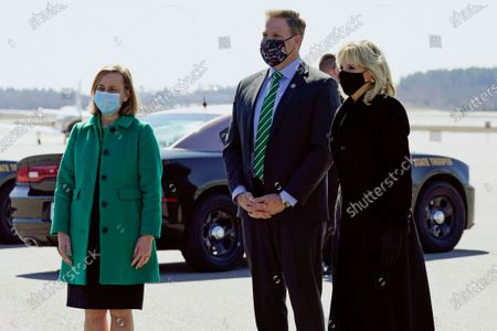 First lady Jill Biden, right, talks with N.H. Gov. Chris Sununu, center, and Manchester, N.H., Mayor Joyce Craig, right, after arriving at Manchester-Boston Regional Airport in Manchester, N.H., . Biden is visiting the area to emphasize that the $1.9 trillion COVID-19 relief plan signed into law by President Joe Biden last week will provide funding for the reopening of schools