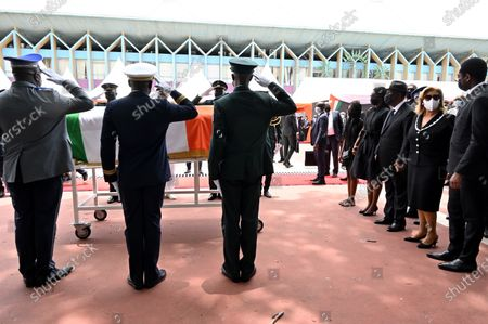 Ivorian President Alassane Ouattara (3-R) and his wife Dominique Folloroux-Ouattara (2-R) and Hamed Bakayoko's children stand behind the coffin of Ivory Coast's late prime minister Hamed Bakayoko during his official tribute ceremony at the presidential palace in Abidjan, Ivory Coast, 17 March 2021. Hamed Bakayoko died on 10 March 2021 following cancer treatment in a German hospital.