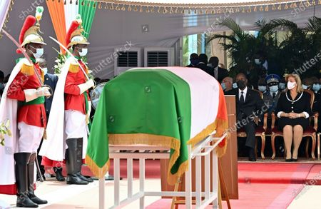 Ivorian President Alassane Ouattara (2nd R) and his wife Dominique Folloroux-Ouattara (R) sit next to the coffin of Ivory Coast's late prime minister Hamed Bakayoko during his official tribute ceremony at the presidential palace in Abidjan, Ivory Coast, 17 March 2021. Hamed Bakayoko died on 10 March 2021 following cancer treatment in a German hospital.