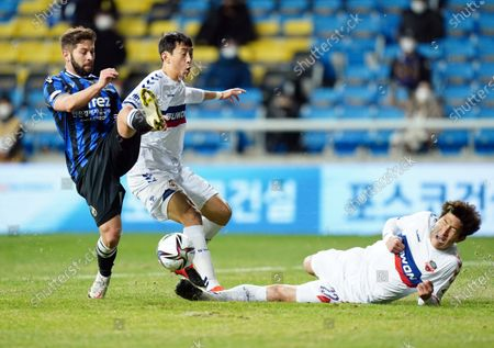 Yun Young-sun of Suwon FC trys to block during the K League 1 match between Incheon United and Suwon FC at the Incheon Football Stadium in Incheon, South Korea, 17 March 2021.