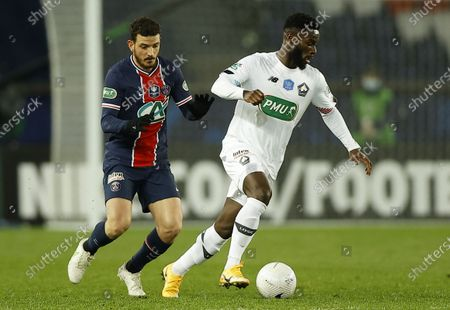 Alessandro Florenzi (L) of Paris Saint Germain and Jonathan Bamba of Lille OSC in action during the Coupe de France (French Cup) soccer match between Paris Saint Germain and Lille OSC in Paris, France, 17 March 2021.