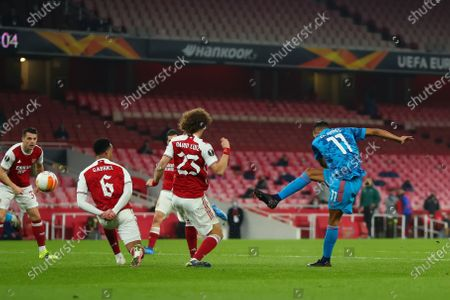 Youssef El Arabi of Olympiakos shoots and scores past David Luiz for 0-1 in the 51st minute; Emirates Stadium, London, England; UEFA Europa League Football, Arsenal versus Olympiacos.