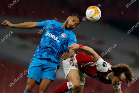 Youssef El Arabi of Olympiakos wins a header against David Luiz of Arsenal; Emirates Stadium, London, England; UEFA Europa League Football, Arsenal versus Olympiacos.