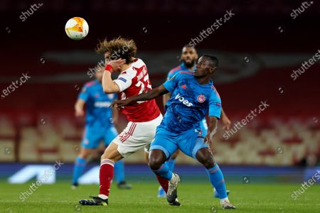 Mady Camara of Olympiakos competes for the ball with David Luiz of Arsenal; Emirates Stadium, London, England; UEFA Europa League Football, Arsenal versus Olympiacos.