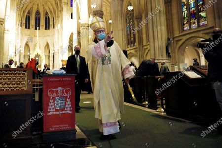 Archbishop of New York, Cardinal Timothy M. Dolan, (C) greets people at Saint Patrick's Cathedral during a private Mass for invited guests on St. Patricks Day in New York, New York, USA, 17 March 2021. The annual New York City Saint Patrick's Day Parade was again cancelled this year due to the Covid-19 pandemic restrictions.