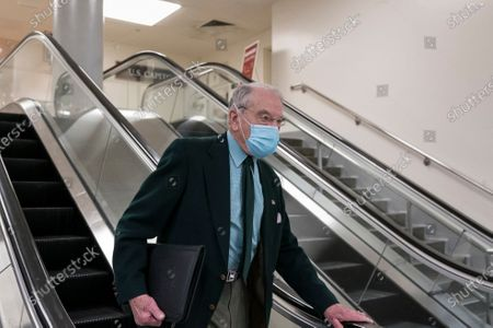 Sen. Chuck Grassley, R-Iowa, takes an escalator following a votes on Biden administration nominees, at the Capitol in Washington