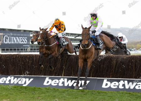 CHELTENHAM. RACE 4 Betway Queen Mother Champion Chase WINNER Put The Kettle On ( LEFT IN ORANGE ) with Chacun Poir Soi ( right in pink ) JOCKEY Aidan Coleman TRAINER Henry De Bromhead