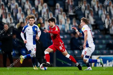 Liam Walsh of Bristol City is challenged by Lewis Holtby and Harvey Elliott of Blackburn Rovers