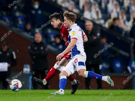 Liam Walsh of Bristol City is challenged by Lewis Holtby of Blackburn Rovers